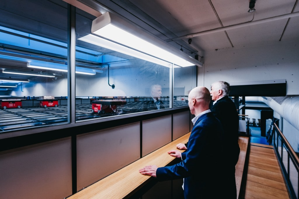 Jan Kleven and Roger Furnes look out at the AutoStore-robots on the grid.