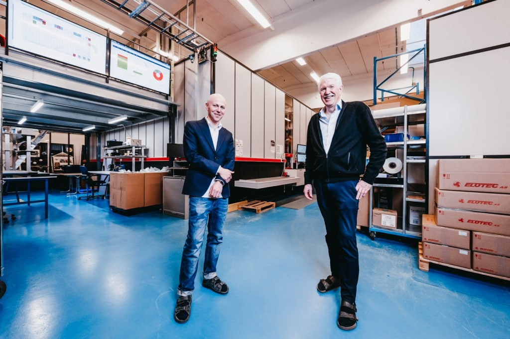 Roger Furnes and Jan Klevin standing inside the Elotec warehouse.